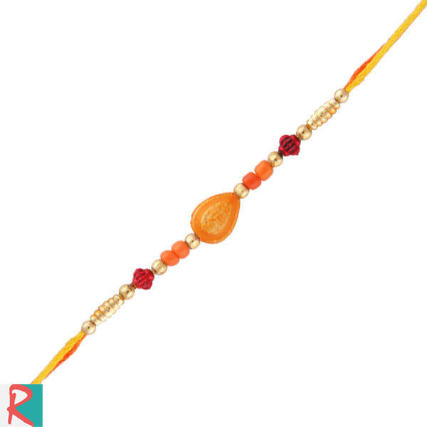 Shell with pearl string rakhi