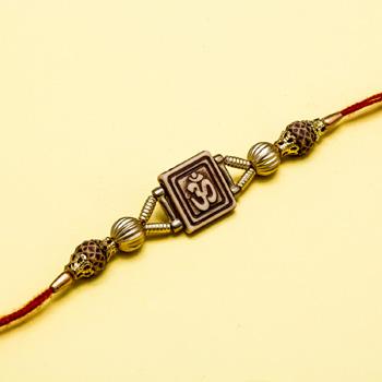 Golden om rudraksha rakhi