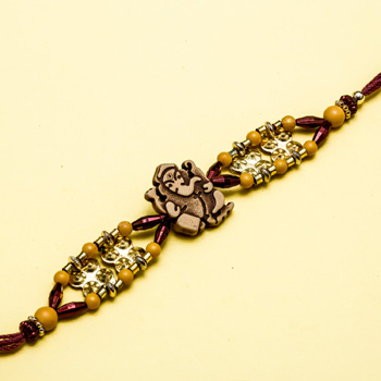 Ganesh wood diamond rakhi