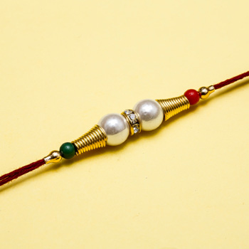 Great art of pearl and diamond rakhi