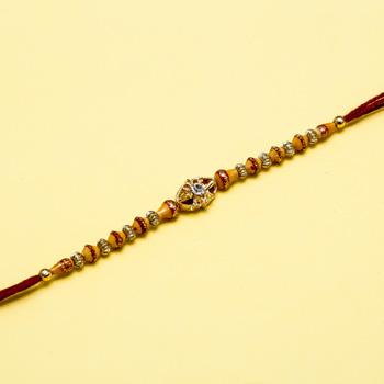 Diligent diamond rakhi for brother